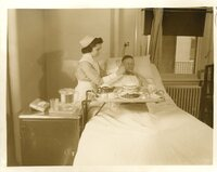 Nurse Feeding Patient Kosher Meal